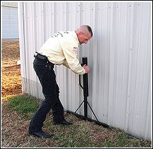 Ned Bruha installing Dig DeFence around an outdoor shed.