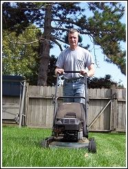 man mowing lawn as part of a humane wildlife prevention plan