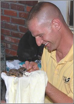 Ned Bruha holding a cute flying squirrel recently removed from an attic