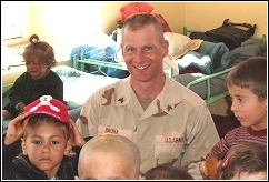 Ned visiting an orphanage during his deployment overseas