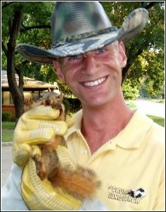 ned bruha with a squirrel he's recently removed from an Oklahoma home